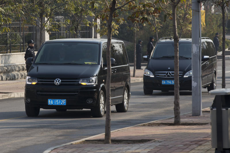 A convoy of vehicles believed to be carrying ousted Chinese politician Bo Xilai head to Shandong Provincial Higher People's Court in Jinan, in eastern China's Shandong province, Friday, Oct. 25, 2013. The court said earlier this week in a notice on its website that Bo's appeal will be heard Friday morning. (AP Photo/Alexander F. Yuan)