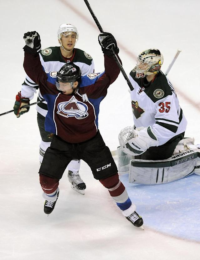 Colorado Avalanche center Paul Stastny, front left, celebrates a game-winning goal by Nathan MacKinnon as Minnesota Wild defenseman Jared Spurgeon, rear, and goalie Darcy Kuemper, right, look on in overtime in Game 5 of an NHL hockey first-round playoff series on Saturday, April 26, 2014, in Denver. The Avalanche won 4-3. (AP Photo/Chris Schneider)