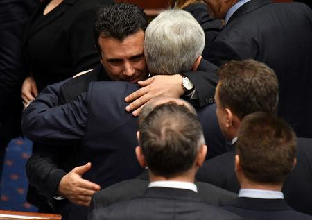 Macedonian Prime Minister Zoran Zaev greets deputies of the Macedonian parliament after a vote to pass constitutional changes to allow the Balkan country to change its name to the Republic of North Macedonia, in Skopje, Macedonia, January 11, 2019.REUTERS/ Tomislav Georgiev