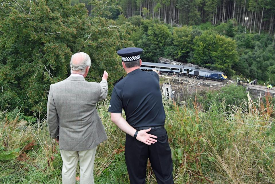 The Prince of Wales is shown the scene of the ScotRail train derailment near Stonehaven, Aberdeenshire, which cost the lives of three people on Wednesday.