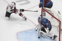 Arizona Coyotes' Christian Fischer (36) is stopped by Colorado Avalanche goalie Philipp Grubauer (31) during the first period of a first round NHL Stanley Cup playoff hockey series in Edmonton, Alberta, Friday, Aug. 14, 2020. (Jason Franson/The Canadian Press via AP)