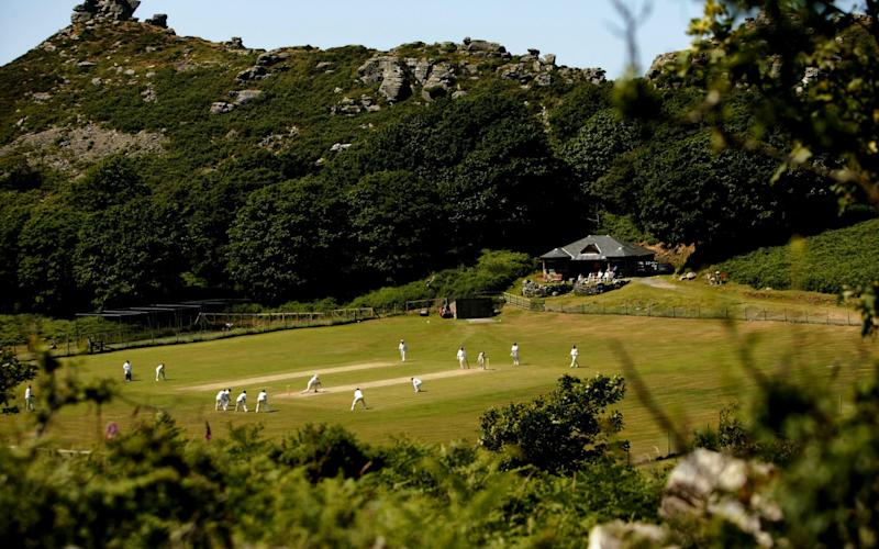 Cricketers from Lynton and Lynmouth Cricket Club playing in the 'Valley of The Rocks' - GETTY IMAGES