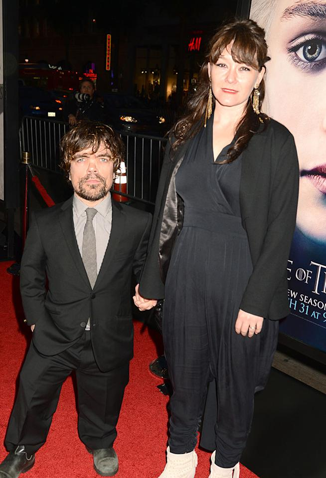 "Peter Dinklage and Erica Schmidt arrive at the premiere of HBO's ""Game of Thrones"" Season 3 at TCL Chinese Theatre on March 18, 2013 in Hollywood, California."
