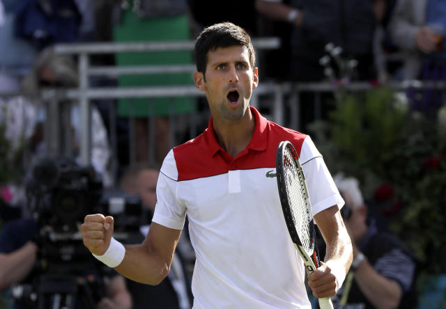 Novak Djokovic of Serbia celebrates winning his match against Grigor Dimitrov of Bulgaria during their singles tennis match at the Queen's Club tennis tournament in London, Thursday, June 21, 2018. (AP Photo/Kirsty Wigglesworth)