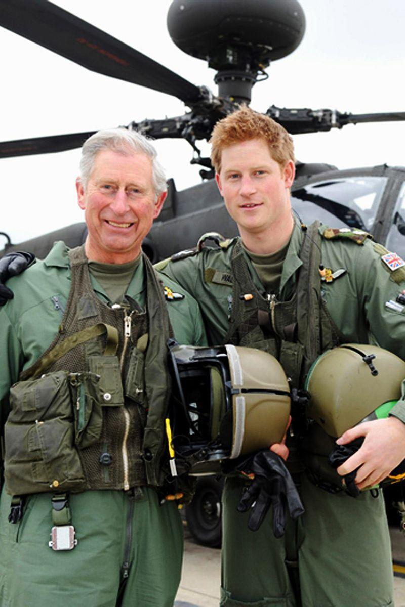 <p>Standing in front of an Apache helicopter with Prince Harry during their visit to the Apache Conversion Course.</p>