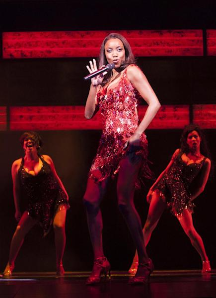 In this undated image made available Thursday Dec. 6, 2012, by the Adelphi Theatre, showing Heather Headley performing in the lead role in the new stage show musical The Bodyguard, directed by Thea Sharrock, not pictured, which is due to open at the Adelphi Theatre in London in December 5, 2012. The stage show is based on the 1992 Bodyguard movie starring Whitney Houston in the lead role. (AP Photo / Paul Coltas, Adelphi Theatre)