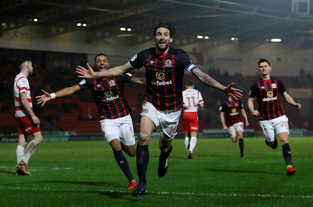 "Soccer Football - League One - Doncaster Rovers v Blackburn Rovers - Keepmoat Stadium, Doncaster, Britain - April 24, 2018 Blackburn Rovers' Charlie Mulgrew celebrates scoring their first goal Action Images/Lee Smith EDITORIAL USE ONLY. No use with unauthorized audio, video, data, fixture lists, club/league logos or ""live"" services. Online in-match use limited to 75 images, no video emulation. No use in betting, games or single club/league/player publications. Please contact your account representative for further details."
