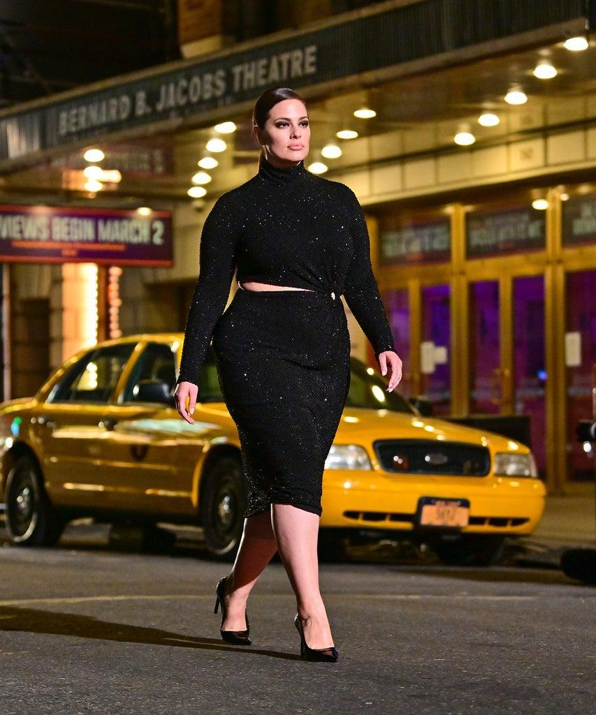NEW YORK, NEW YORK – APRIL 08: Ashley Graham walks along 46th Street during the Michael Kors Fashion Show in Times Square on April 08, 2021 in New York City. (Photo by James Devaney/GC Images)