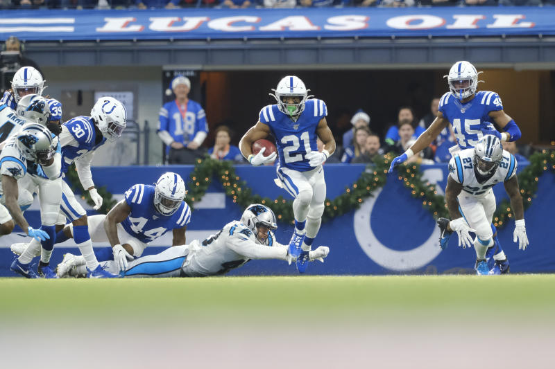 Indianapolis Colts' Nyheim Hines runs back a punt for a touchdown during the first half of an NFL football game against the Carolina Panthers, Sunday, Dec. 22, 2019, in Indianapolis. (AP Photo/AJ Mast)