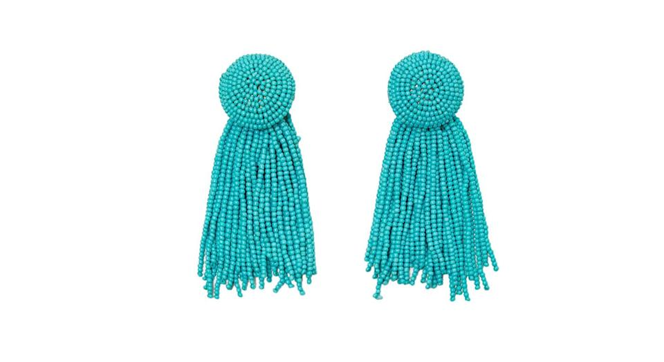 """<p>These turquoise dangly earrings are the perfect addition to any summer outfit. <br><a rel=""""nofollow noopener"""" href=""""https://www.zara.com/uk/en/beaded-fringe-earrings-p02673205.html?v1=6454987&gclid=EAIaIQobChMIq66TmeaA3AIVSLTtCh196AUDEAYYASABEgJmnvD_BwE&gclsrc=aw.ds&dclid=CPG1u6TmgNwCFYx00wodsOIDoA"""" target=""""_blank"""" data-ylk=""""slk:Buy here."""" class=""""link rapid-noclick-resp"""">Buy here.</a> </p>"""