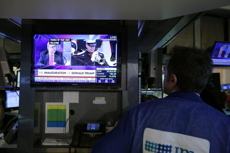 A trader watches the Trump inauguration on TV on the floor of the New York Stock Exchange (NYSE) in Manhattan, New York City