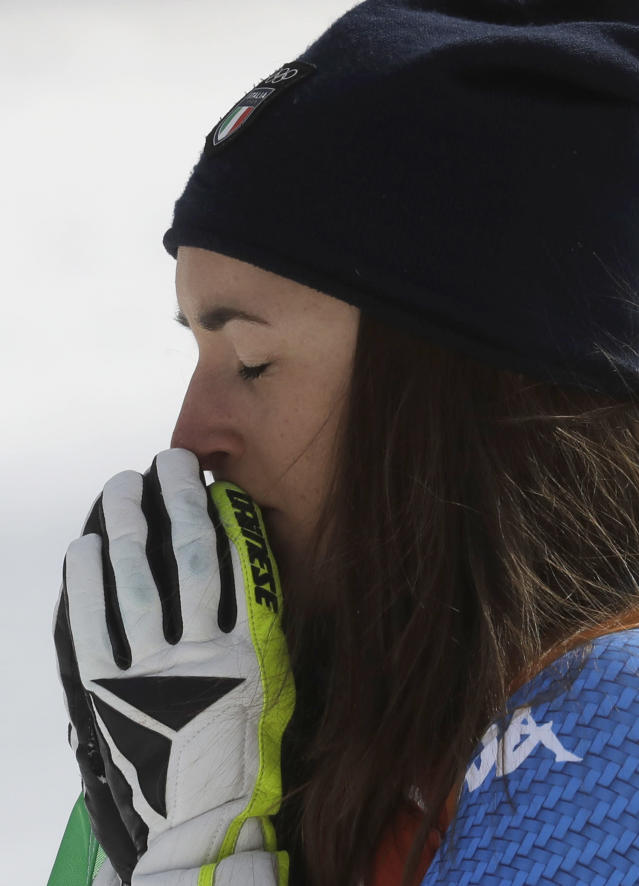 Gold medal winner Sofia Goggia, of Italy, reacts during the flower ceremony for the women's downhill at the 2018 Winter Olympics in Jeongseon, South Korea, Wednesday, Feb. 21, 2018. (AP Photo/Michael Probst)