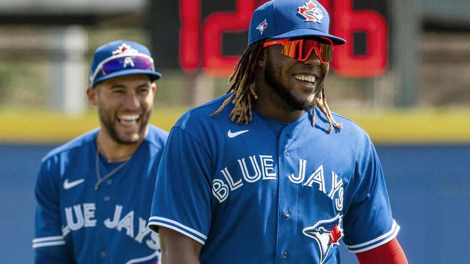 Toronto Blue Jays' Vladimir Guerrero Jr., right, and George Springer share a laugh before a spring training baseball game against the Philadelphia Phillies Tuesday, March 2, 2021, at TD Ballpark in Dunedin, Fla. THE CANADIAN PRESS/Steve Nesius