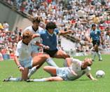 Diego Maradona (dark blue jersey) en route to scoring one of the greatest goals in football history, dribbling past England defenders in the 1986 World Cup quarter-finals. (PHOTO: Staff/AFP via Getty Images)