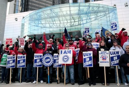 Striking United Auto Workers (UAW) members rally in front of General Motors World headquarters in Detroit