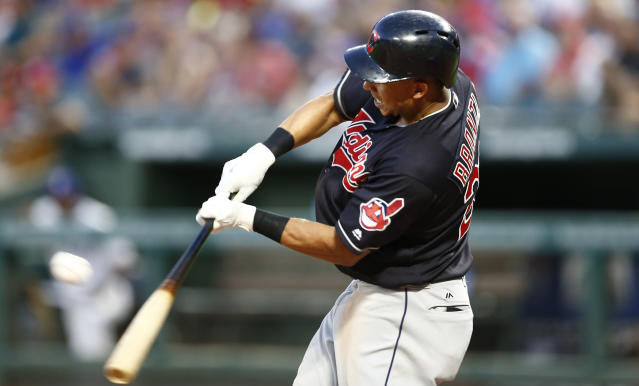 Cleveland Indians' Michael Brantley connects for an RBI-single against the Texas Rangers during the fifth inning of a baseball game, Saturday, July 21, 2018, in Arlington, Texas. (AP Photo/Jim Cowsert)