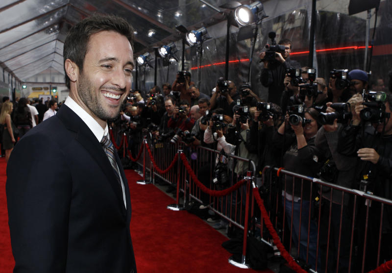 """FILE - In this Wednesday, April 21, 2010, file photo, cast member Alex O'Loughlin arrives at the premiere of """"The Back-up Plan"""" in Los Angeles. O'Loughlin says he's signed up for two more seasons of """"Hawaii Five-0"""" but is looking forward to a career beyond the hit TV series. (AP Photo/Matt Sayles, File)"""