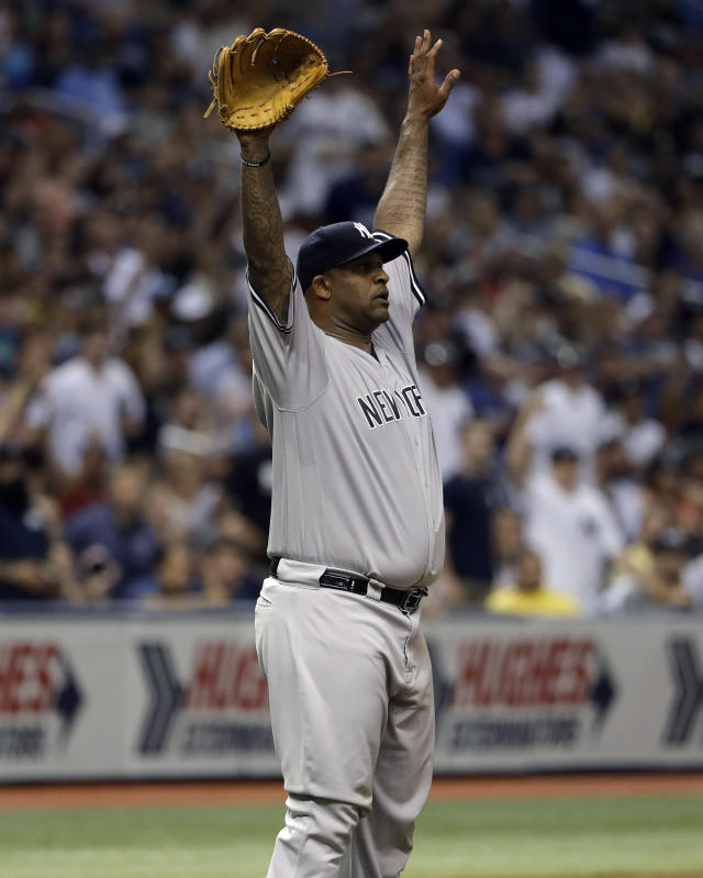 New York Yankees starting pitcher CC Sabathia celebrates a catch by left fielder Giancarlo Stanton on a fly-out by Tampa Bay Rays' C.J. Cron during the fifth inning of a baseball game Friday, June 22, 2018, in St. Petersburg, Fla. (AP Photo/Chris O'Meara)