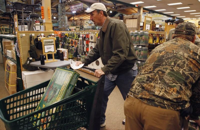"""Shoppers rush to grab items inside a Cabela's store on the shopping day dubbed """"Black Friday"""" in Fort Worth"""