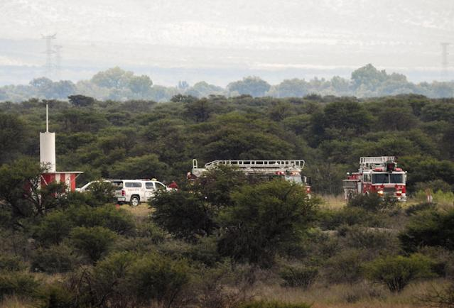 <p>Fire engines are seen near the wreckage of a plane (out of frame) that crashed with 97 passengers and four crew on board on take off at the airport of Durango, in northern Mexico, on July 31, 2018. (Photo: Kevin Alcantar/Kevin Alcantar Drones Durango/AFP/Getty Images) </p>