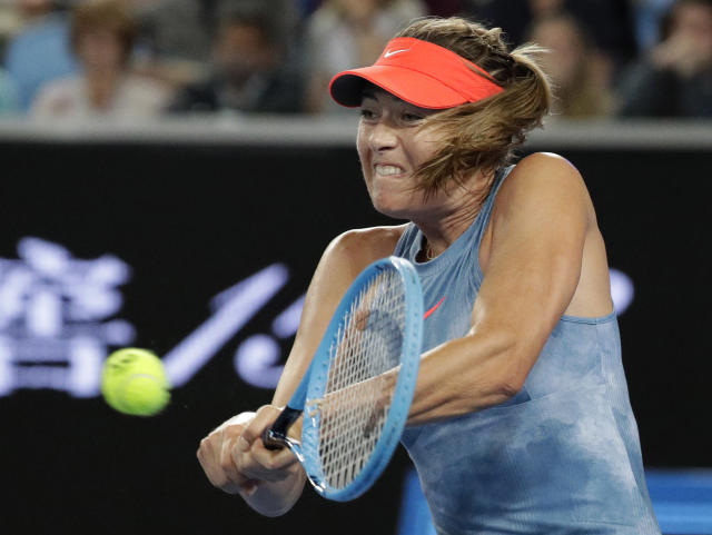Russia's Maria Sharapova makes a backhand return to Sweden's Rebecca Peterson during their second round match at the Australian Open tennis championships in Melbourne, Australia, Wednesday, Jan. 16, 2019. (AP Photo/Aaron Favila)