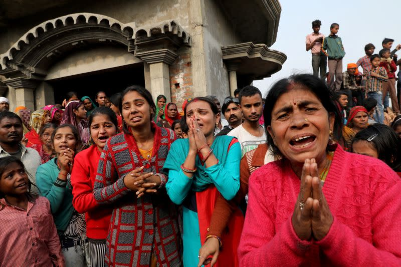 FILE PHOTO: Relatives of accused react as they demand a Central Bureau of Investigation probe into rape of a 23-year-old victim, who died in a New Delhi hospital on Friday, after she was set on fire by a gang of men, which included her alleged rapists