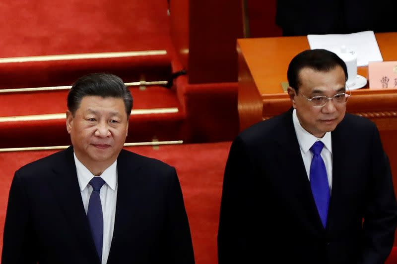 Chinese President Xi Jinping and Premier Li Keqiang arrive for the opening session of CPPCC in Beijing