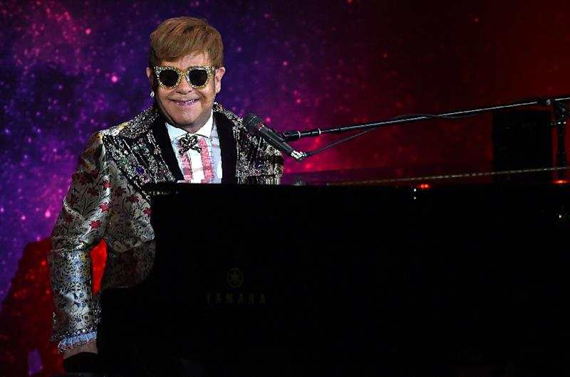 Sir Elton John, 72, rocketed to stardom through a combination of virtuoso musical talent, flamboyant performances and unforgettable pop songs (AFP Photo/TIMOTHY A. CLARY)