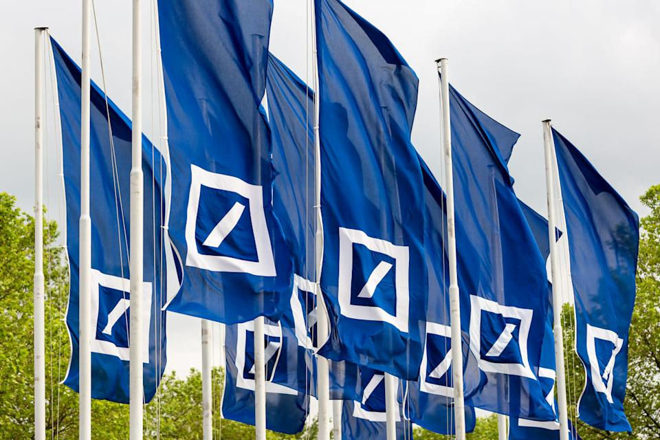 Numerous blue flags with Deutsche Bank logo on them.