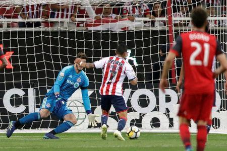 Soccer Football - CONCACAF Champions League Final Second Leg - Guadalajara vs Toronto FC - Estadio Akron, Guadalajara, Mexico - April 25, 2018 Guadalajara's Orbelin Pineda scores their first goal REUTERS/Henry Romero