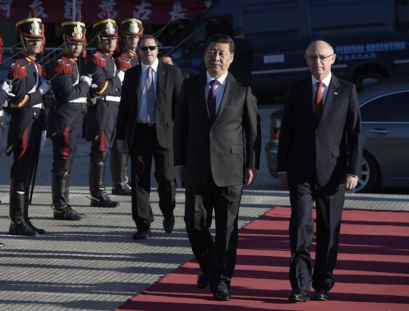 China's President Xi Jinping (L), accompanied by Argentine Foreign Minister Hector Timerman, arrives at Plaza San Martin square to pay homage to Argentine XIX century hero General Jose de San Martin in Buenos Aires, on July 19, 2014