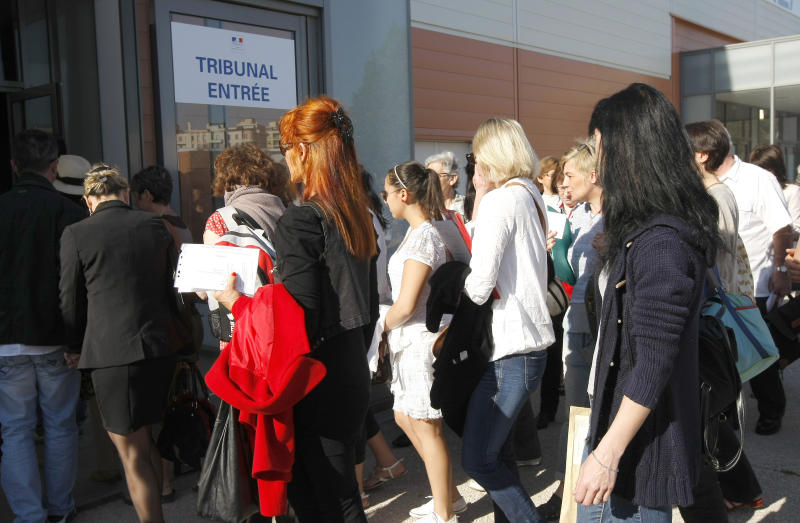 Plaintiffs arrive at th Parc Chanot temporary courthouse in Marseille, Southern France, to attend the trial of Jean-Claude Mas, who founded and ran breast implant-maker Poly Implant Prothese, Wednesday, April 17, 2013. Some hundreds of women who received faulty breast implants are gathering in the south of France to witness the fraud trial of five executives accused of using cheap industrial silicone to fill tens of thousands of implants around the world. The now-defunct company exported to more than 60 countries and was one of the world's leading implant makers.(AP Photo/Claude Paris)