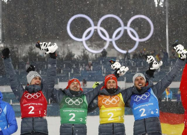 Nordic Combined Events - Pyeongchang 2018 Winter Olympics - Men's Team 4 x 5 km Final - Alpensia Cross-Country Skiing Centre - Pyeongchang, South Korea - February 22, 2018 - Gold medalists Vinzenz Geiger, Fabian Riessle, Eric Frenzel and Johannes Rydzek of Germany celebrate during the victory ceremony. REUTERS/Kai Pfaffenbach