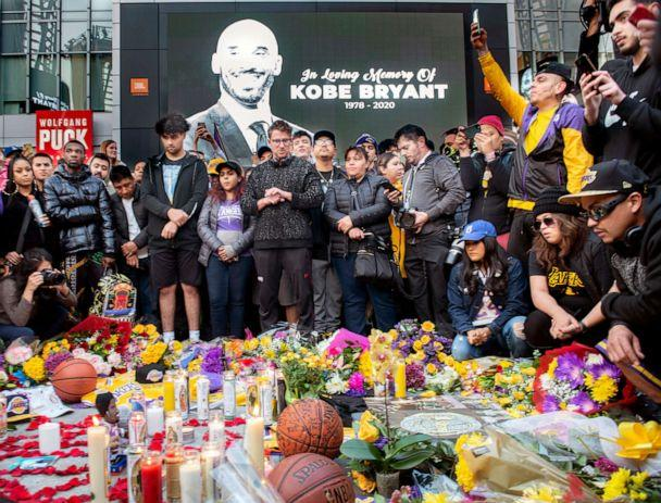 PHOTO: People gather in front of a makeshift memorial for former NBA and Los Angeles Lakers player Kobe Bryant and his daughter Gianna Bryant, on Jan. 26, 2020, at LA Live plaza in front of Staples Center in Los Angeles. (MediaNews Group via Getty Images, FILE)