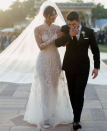 <p>Priyanka made if official in a one-of-a-kind wedding gown designed by Ralph Lauren. It was hand crafted with 5,600 pearl seed beads, 11,632 Swarovski crystals and 24,12,000 high-luster sequins. </p>