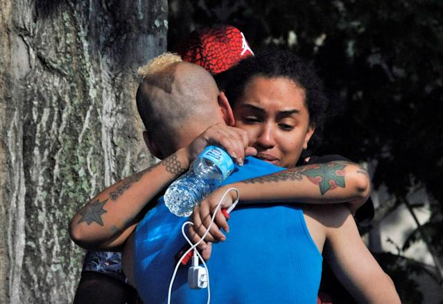 <p>Friends and family members embrace outside the Orlando Police Headquarters during the investigation of a shooting at the Pulse nightclub, where people were killed by a gunman, in Orlando, June 12, 2016. (REUTERS/Steve Nesius) </p>