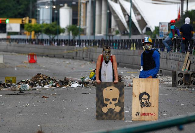 <p>Opposition supporters stand behind a barricade as the Constituent Assembly election was being carried out in Caracas, Venezuela, July 30, 2017. (Christian Veron/Reuters) </p>