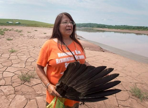 Dorene Bernard stands on the shores of the Shubenacadie River during a protest over a gas project in 2018.  (Andrew Vaughan/The Canadian Press - image credit)