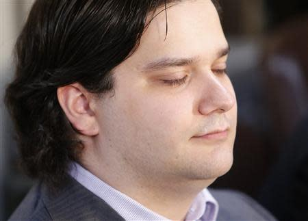 Mark Karpeles, chief executive of Mt. Gox, attends a news conference at the Tokyo District Court in Tokyo February 28, 2014. Mt. Gox, once the world's biggest bitcoin exchange, filed for bankruptcy protection on Friday, saying it may have lost all of its investors' virtual coins due to hacking into its faulty computer system. REUTERS/Yuya Shino