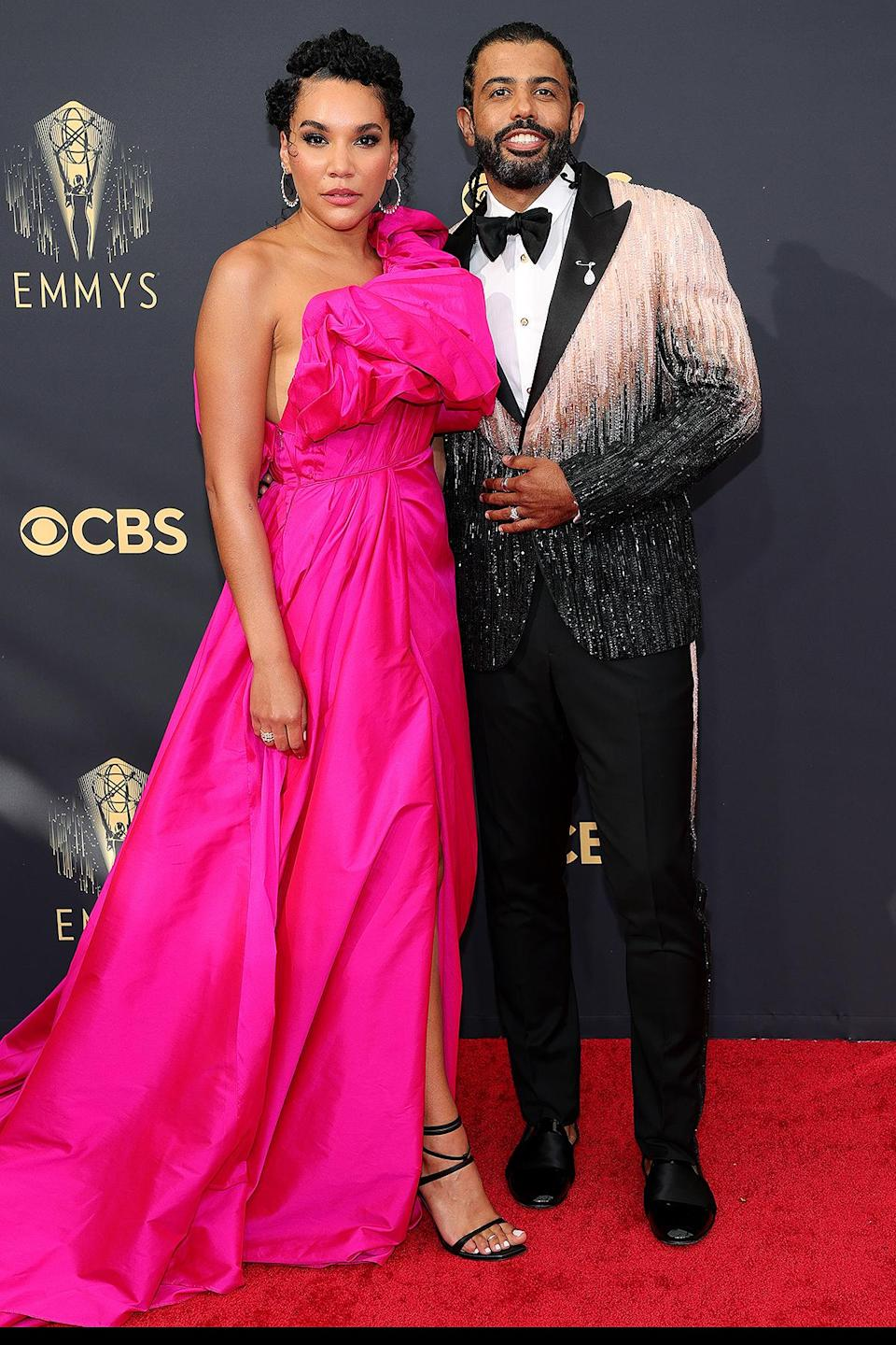 <p>The <em>Hamilton </em>star sparkled and shined on the red carpet in a beaded pink and black tux, matching his partner Emmy Raver-Lampman, who also opted for a pink look. </p>