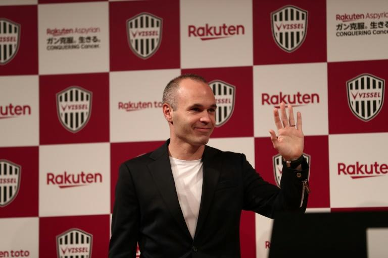 Andres Iniesta waves as he is presented as a Vissel Kobe player at a press conference in Tokyo on Thursday