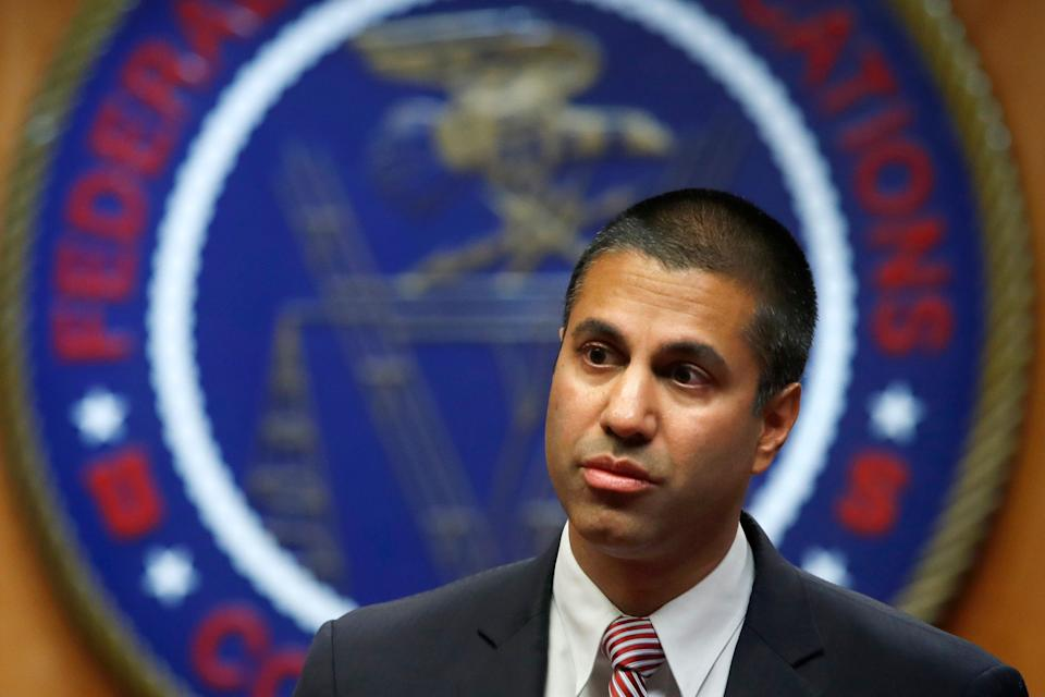 FILE - In this Dec. 14, 2017 file photo, Federal Communications Commission (FCC) Chairman Ajit Pai arrives for an FCC meeting where they will vote on net neutrality in Washington.  Published reports say Pai is skipping the CES gadget show because of death threats. Pai has scrapped popular net-neutrality rules that had barred broadband providers like AT&T, Comcast and Verizon from interfering with internet traffic. The policy's supporters have reacted strongly. Pai and his staff have called out racist tweets and death threats against the chairman. AP Photo/Jacquelyn Martin, File)