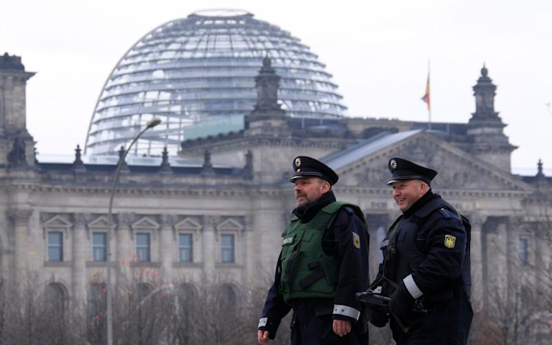 German police patrol outside Chancellery near Reichstag building in Berlin - THOMAS PETER/Reuters