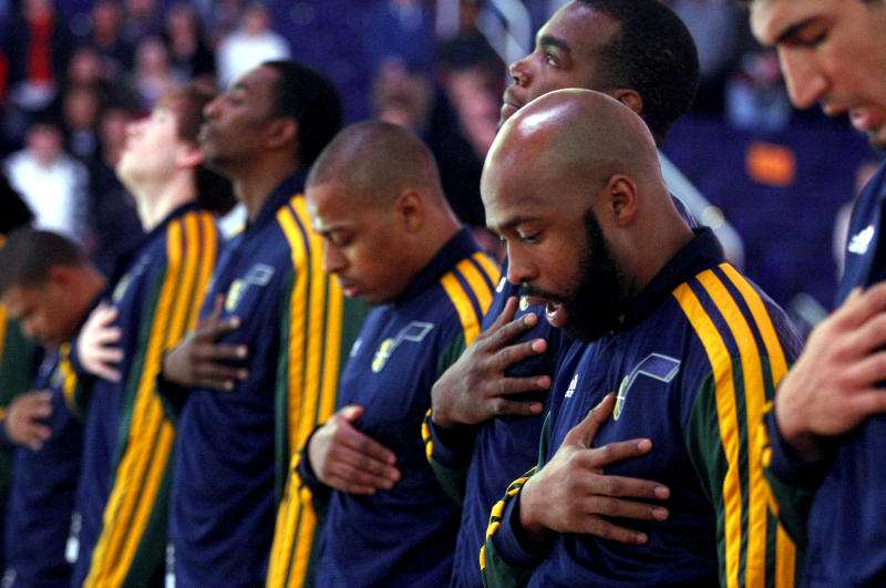 Utah Jazz point guard Jamaal Tinsley (6) and teammates take a moment of silence before an NBA basketball game against the Phoenix Suns Friday, Dec. 14, 2012, on behalf of the school shooting victims in Connecticut earlier today and their families in Phoenix. (Rick Scuteri/AP Photos)