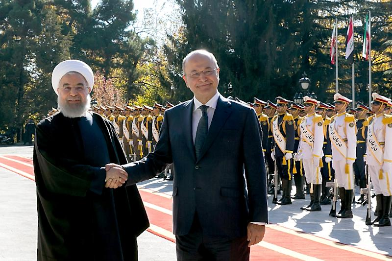 Iraq's new President Barham Salih (R) meets Iranian counterpart Hassan Rouhani on his official visit to Tehran (AFP Photo/-)