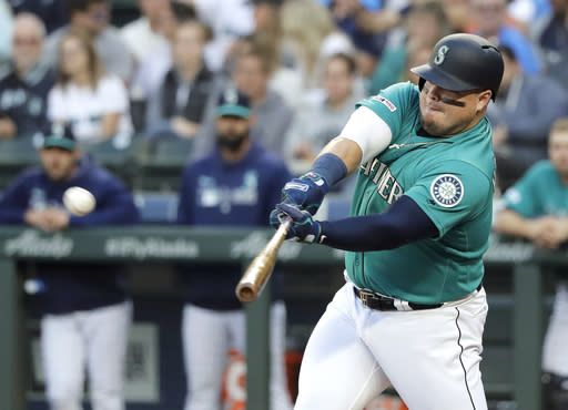 Seattle Mariners' Daniel Vogelbach hits a three-run home run during the fourth inning of a baseball game against the Los Angeles Angels, Friday, July 19, 2019, in Seattle. (AP Photo/Ted S. Warren)