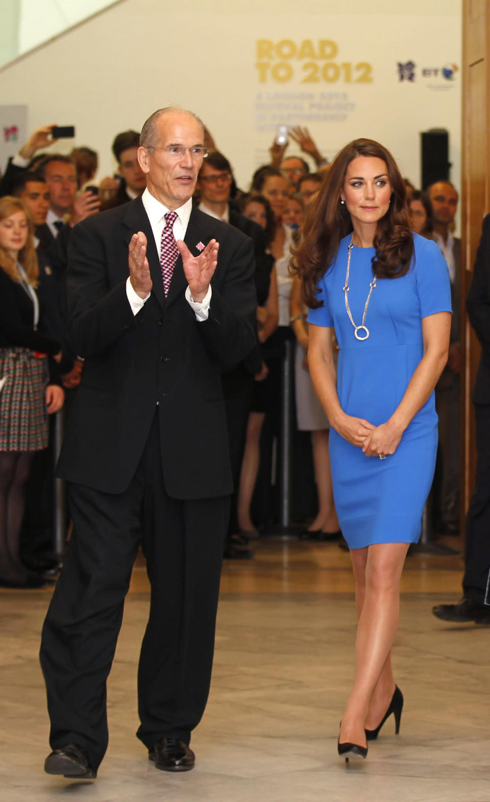 <p>Visiting an exhibition at the National Portrait Gallery, Kate donned a favourite blue Stella McCartney dress with a circular Cartier necklace. She completed the look with black Prada heels.</p><p><i>[Photo: PA]</i></p>