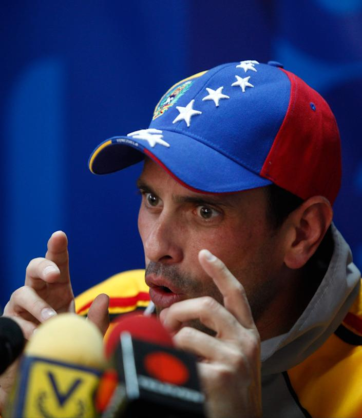Opposition leader Henrique Capriles speaks during a news conference at his office in Caracas, Venezuela, Thursday, Feb. 20, 2014. The opposition is planning marches across the country on Saturday to protest the jailing of opposition leader Leopoldo Lopez, which has made him a cause celebre among opponents of President Maduro. Capriles, the opposition's two-time presidential candidate is now being eclipsed by Lopez as leader of the opposition. (AP Photo/Alejandro Cegarra)