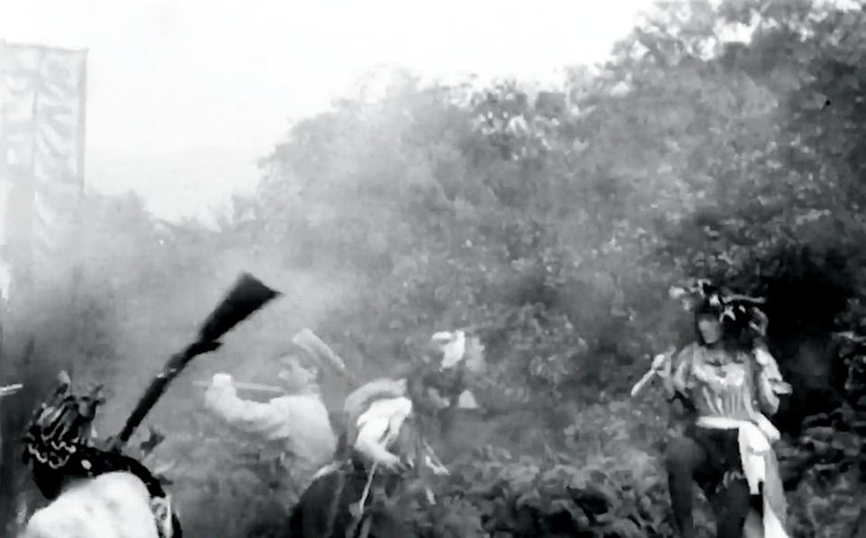Screengrab from the movie ''Kidnapping by Indians'' filmed in Blackburn in 1899.  Astonishing new research has revealed the first ever Western film was not shot in the United States - but BLACKBURN in Lancashire.  See SWNS story SWLEwestern.  The movie ''Kidnapping by Indians'' was filmed in 1899 -  four years before The Great Train Robbery which until now was widely seen as the genre's first film.  Shot in Lancashire countryside, the two minute movie is about a pair of cowboys who rescue a white woman from native American kidnappers.   It was made by Blackburn film company Mitchell & Kenyon which was a pioneer of early commercial motion pictures at the start of the 20th century.   Mitchell & Kenyon's cache of movies have become much-loved since they were discovered in barrels underneath their old headquarters in 1994.   But the first proper study of the film has revealed it was made in 1899 - and predates what was previously held as the first ever Western.  Many of the films, including Kidnapping By Indians, are now kept by the British Film Institute (BFI), which has revealed the remarkable revelation.