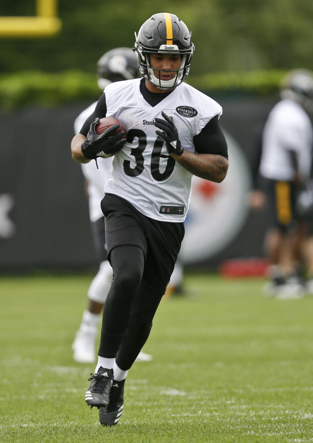 FILE - This file photo from May 22, 2018, shows Pittsburgh Steelers running back James Conner (30) as he takes part in drills during NFL football practice in Pittsburgh. Steelers All-Pro Le'Veon Bell is spending his second straight spring working out on his own while waiting to sign his franchise tender. That leaves plenty of reps for potential replacements, from James Conner to rookie Jaylen Samuels. (AP Photo/Keith Srakocic, FILE)
